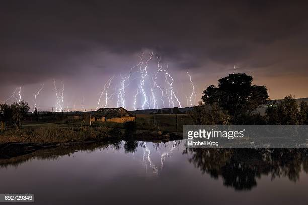 Lightning strikes over abandoned farm house and dam, Magaliesburg, Gauteng Province, South Africa