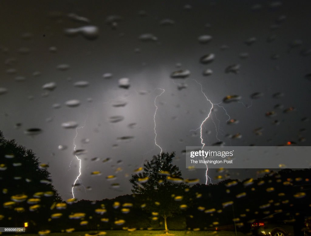 Lightning strikes over Lake Fairfax Park as bands of thunderstorms move through the DC area on Tuesday, May 15, 2018, in Reston, VA.