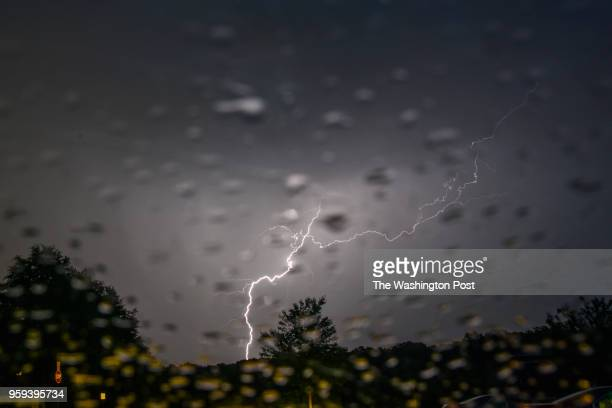 Lightning strikes over Lake Fairfax Park as bands of thunderstorms move through the DC area on Tuesday May 15 in Reston VA