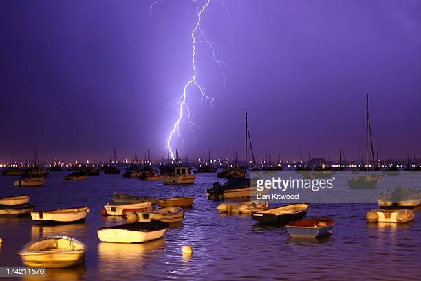 Lightning strikes over Poole Harbour during a thunderstorm on July 21 2013 in Poole England The spell of hot weather was brought to an end last night...