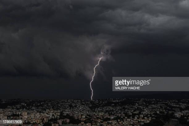 Lightning strikes over the French Riviera city of Nice on September 26, 2021.