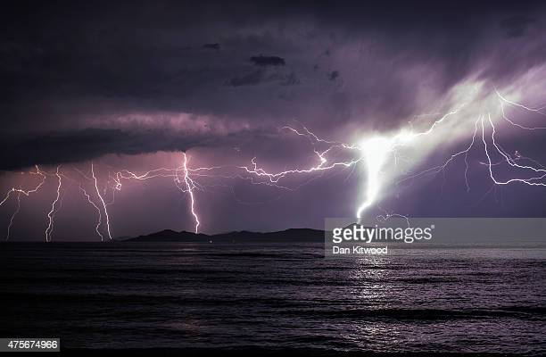 Lightning strikes over the Greek Island of Pserimos on June 03 2015 in Kos Greece Migrants are continuing to arrive on the Greek Island of Kos from...