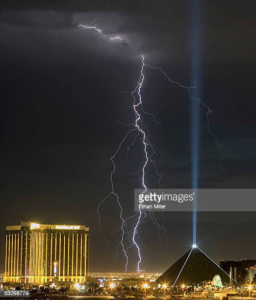 Lightning strikes over the Mandalay Bay Resort Casino and the Luxor Hotel and Casino during a storm July 21 2005 in Las Vegas Nevada