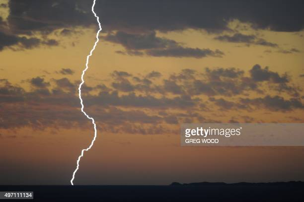Lightning strikes over the ocean at Cottesloe near where Britain's Prince Charles celebrated his 67th birthday at a special birthday barbecue at the...