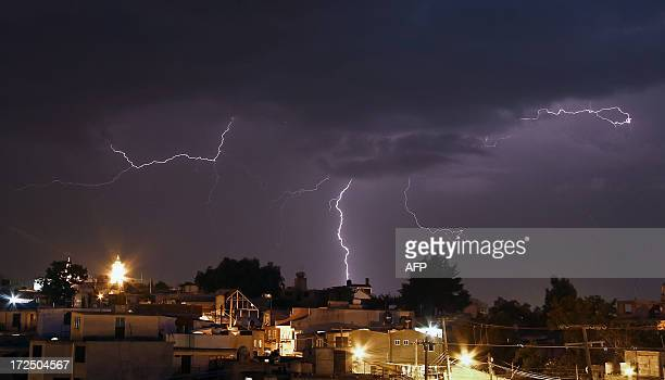 A lightning strikes the San Nicolas Panotla community in the state of Tlaxcala Mexico on July 2 2013 AFP PHOTO/J Guadalupe Pérez