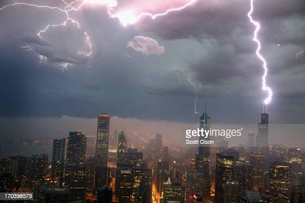 Lightning strikes the Willis Tower in downtown on June 12 2013 in Chicago Illinois A massive storm system with heavy rain high winds hail and...