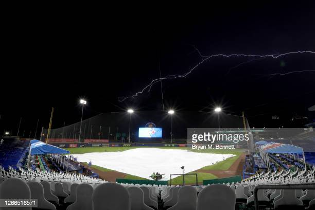 Lightning strikes while on a rain delay during the fourth inning of an MLB game between the Toronto Blue Jays and the Tampa Bay Rays at Sahlen Field...