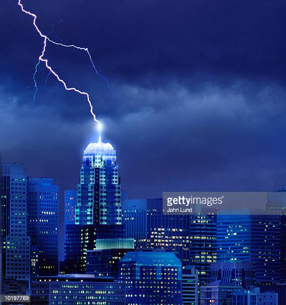 lightning striking antenna on tall building (digital enhancement) - digital enhancement stock pictures, royalty-free photos & images