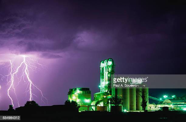 lightning striking near factory in texas - country texas lightning stock pictures, royalty-free photos & images