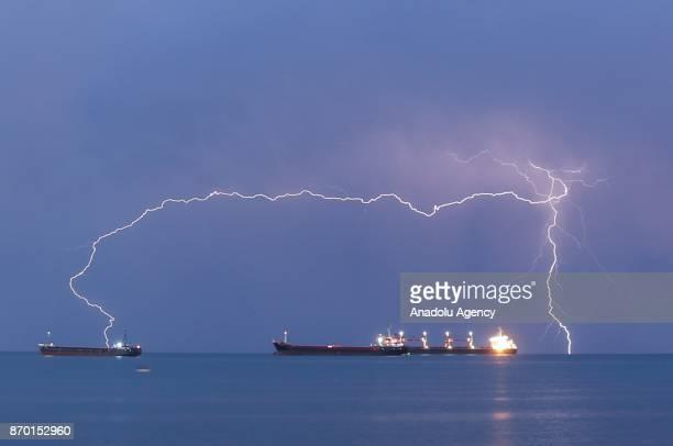 Lightnings brighten the sky over Iskenderun district during rainy evening of Hatay Turkey on November 04 2017
