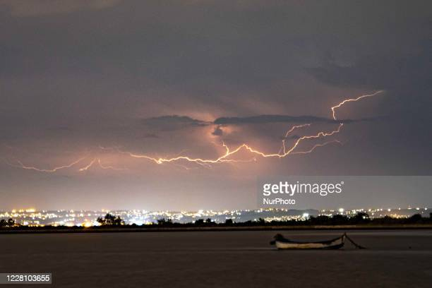 Lightnings during a summer night thunderstorm over Thessaloniki city and the sea as captured from Kalochori Lagoon in Northern Greece The thunder...