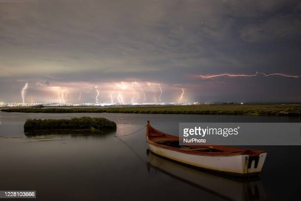 Lightnings during a summer night thunderstorm over Thessaloniki city and the sea as captured from Kalochori Lagoon in Northern Greece. The thunder...
