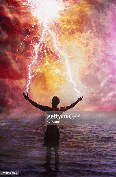 Lightnings emitting from the hands of a man