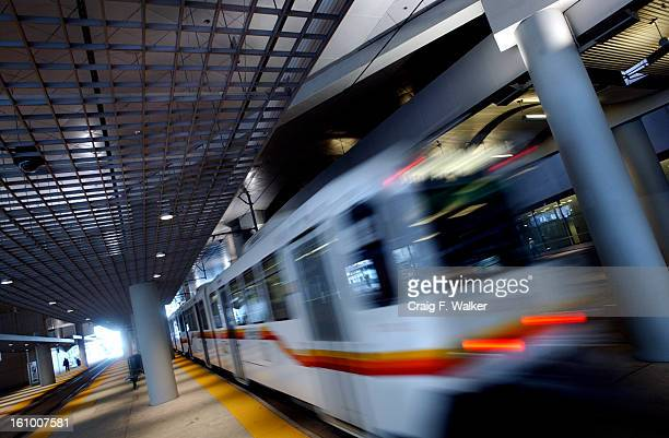 LightRail train passes the Convention Center Performing Arts Station that runs the path of Stout Street under the Center's parking deck in Denver CO...