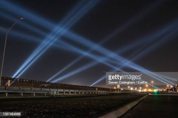 lights against sky at night across us mexico border - steven cottingham stock-fotos und bilder