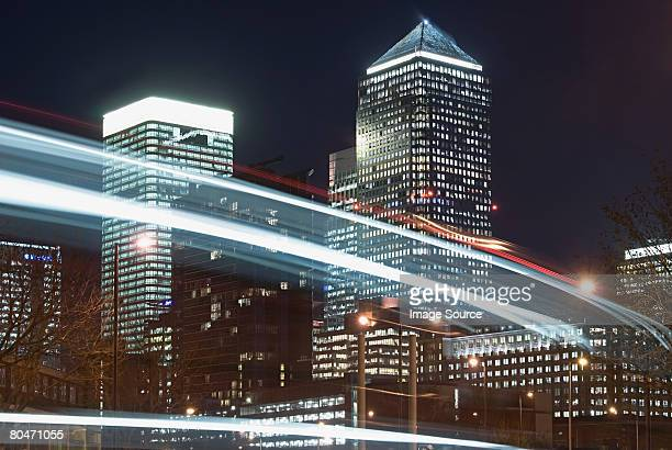 lights and canary wharf - canary wharf stock photos and pictures