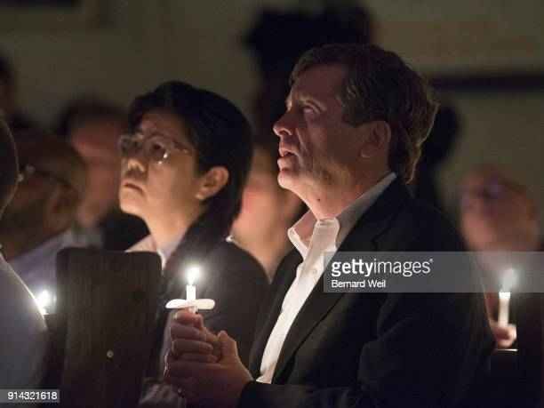 TORONTO ON FEBRUARY 4 Lights are dimmed as members of the congregation including Toronto Mayor John Tory sing the closing song Channel Your Peace at...