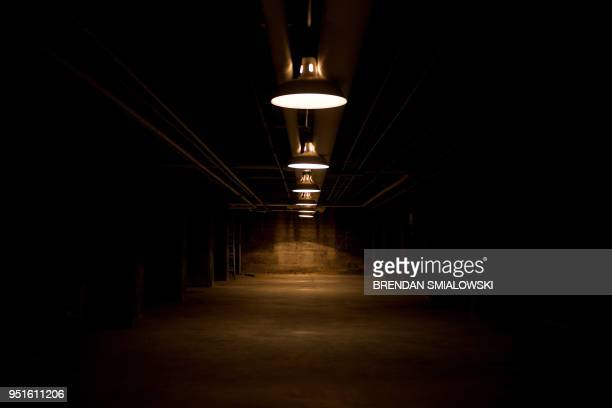 Lights are seen in a former Civil Defense fallout shelter beneath the OysterAdams School April 17 2018 in Washington DC In a longabandoned nuclear...
