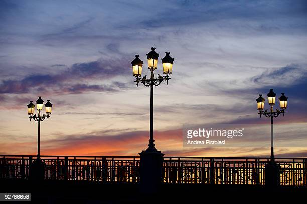 Lights at sunset on St Pierre bridge, Toulouse