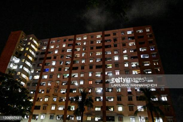Lights coming from apartments of a residential housing complex are seen during a governmentimposed nationwide lockdown as a preventive measure...