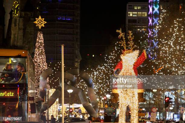 Lights decoration illuminates the Kurfuerstendamm in the final days before Christmas on December 17, 2019 in Berlin, Germany. Retailers are hoping...