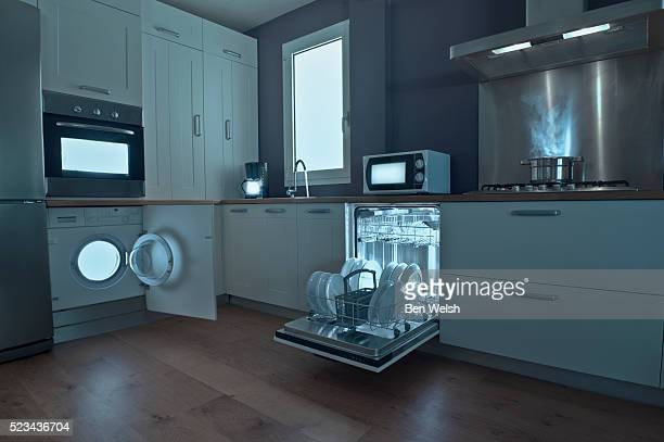 lights from appliances in dark kitchen - appliance stock pictures, royalty-free photos & images