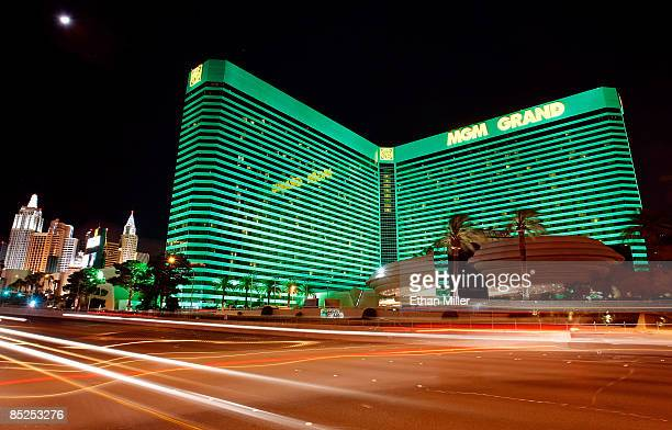 Lights from passing vehicles are seen in front of the New YorkNew York Hotel Casino and the MGM Grand Hotel/Casino March 4 2009 in Las Vegas Nevada...
