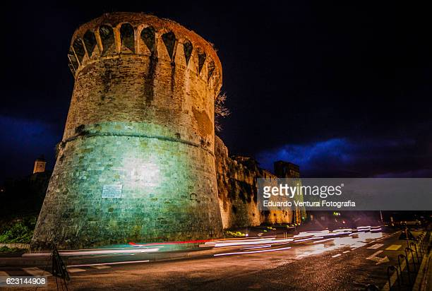 Lights from traffic streak outside the medievel walls of San Gimignano in Italy