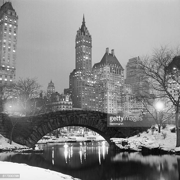 Lights glow in New York buildings as snow blankets the city and Central Park