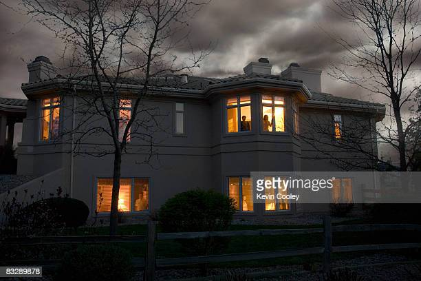 Lights glowing in suburban house