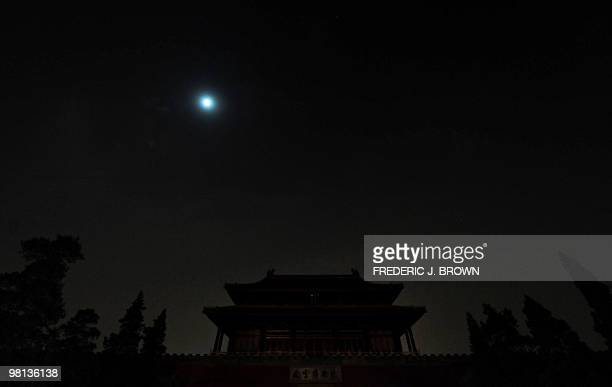 Lights go out over the north gate of the Forbidden City in Beijing during Earth Hour on March 27 with the moon offering the only light in the sky...