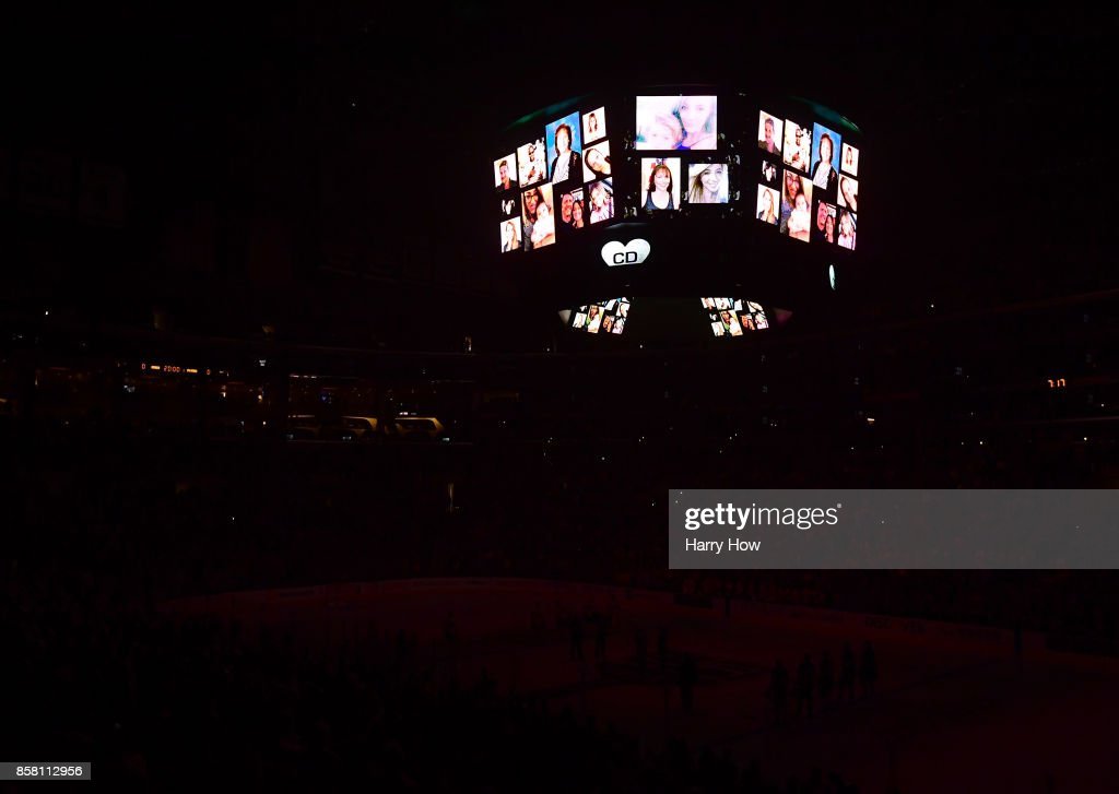 Lights go out with a moment of silence in honor of King's employee Christiana Duarte who was killed in the Las Vegas shooting days earlier during opening night of the Los Angeles Kings 2017-2018 season against the Philadelphia Flyers at Staples Center on October 5, 2017 in Los Angeles, California.