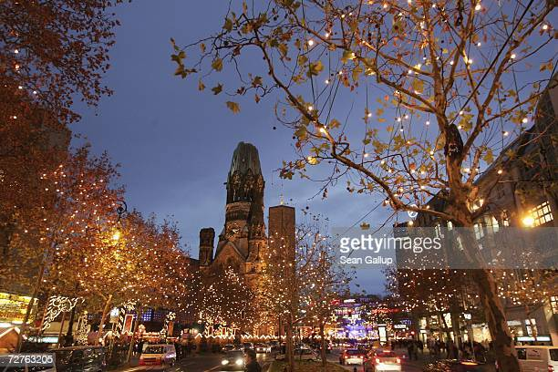 Lights hang on trees during the Christmas shopping season on Kurfuerstendamm avenue Berlin's most famous shopping street December 7 2006 in Berlin...