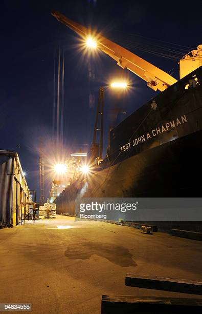 Lights illuminate a dock where the TSGT John A Chapman is loaded with food aid in the Port of Lake Charles in Lake Charles Louisiana US on Monday...