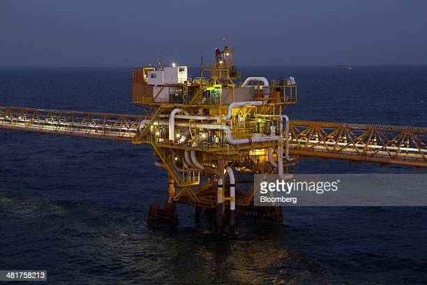 Lights illuminate a link platform part of the Petroleos Mexicanos PolA Platform complex located on the continental shelf in the Gulf of Mexico 70...