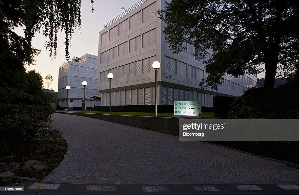 lights illuminate a sign at the entrance to glencore xstrata plc s