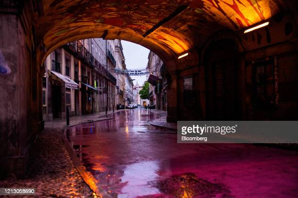 Lights illuminate an archway on Rua Nova do Carvalho, also known as Pink Street, in Cais Sodre, Lisbon, Portugal on Thursday, May 14, 2020. The...