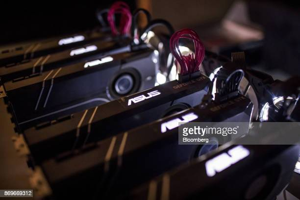 Lights illuminate Asus GeForce GTX machines manufactured by Asustek Computer Inc used for cryptocurrency 'mining' at the home of Eugene Mutai bitcoin...