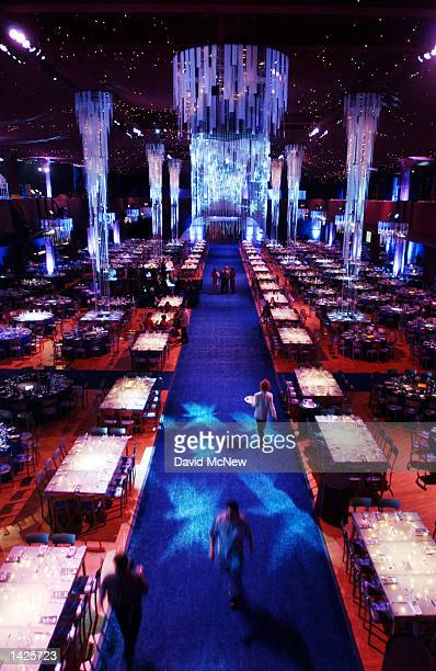 Lights illuminate chandeliers at the venue for the Governor's Ball inside of the Shrine Auditorium September 21 2002 in Los Angeles California The...