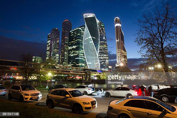Lights illuminate commercial office skyscrapers including the Evolution Tower center and the Mercury City Tower right at the Moscow International...