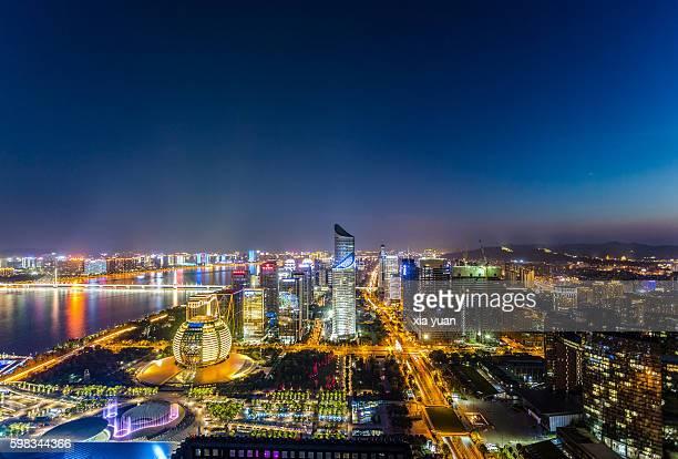 Lights illuminate downtown skyscrapers at night,Hangzhou,China