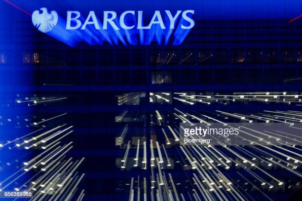 Lights illuminate office windows at the Barclays Plc head offices in the Canary Wharf business financial and shopping district in London UK on...