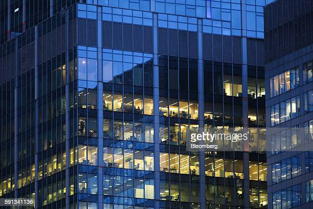Lights illuminate offices in a skyscraper at the Moscow International Business Center also known as Moscow City in Moscow Russia on Tuesday Aug 16...