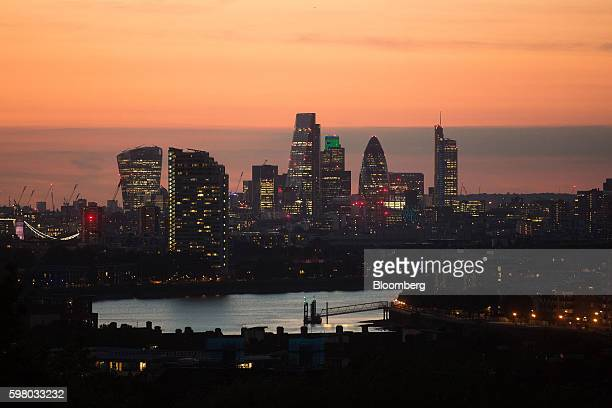 Lights illuminate skyscrapers including 20 Fenchurch Street also known as the 'Walkie Talkie' The Leadenhall building also known as the...