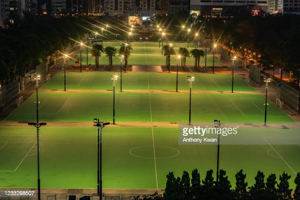 Lights illuminate the closed-off football pitches at Victoria Park, after police closed the venue where Hong Kong people traditionally gather...