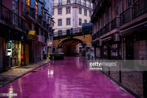 Lights illuminate the deserted Rua Nova do Carvalho, also known as Pink Street, in Cais Sodre, Lisbon, Portugal on Thursday, May 14, 2020. The...