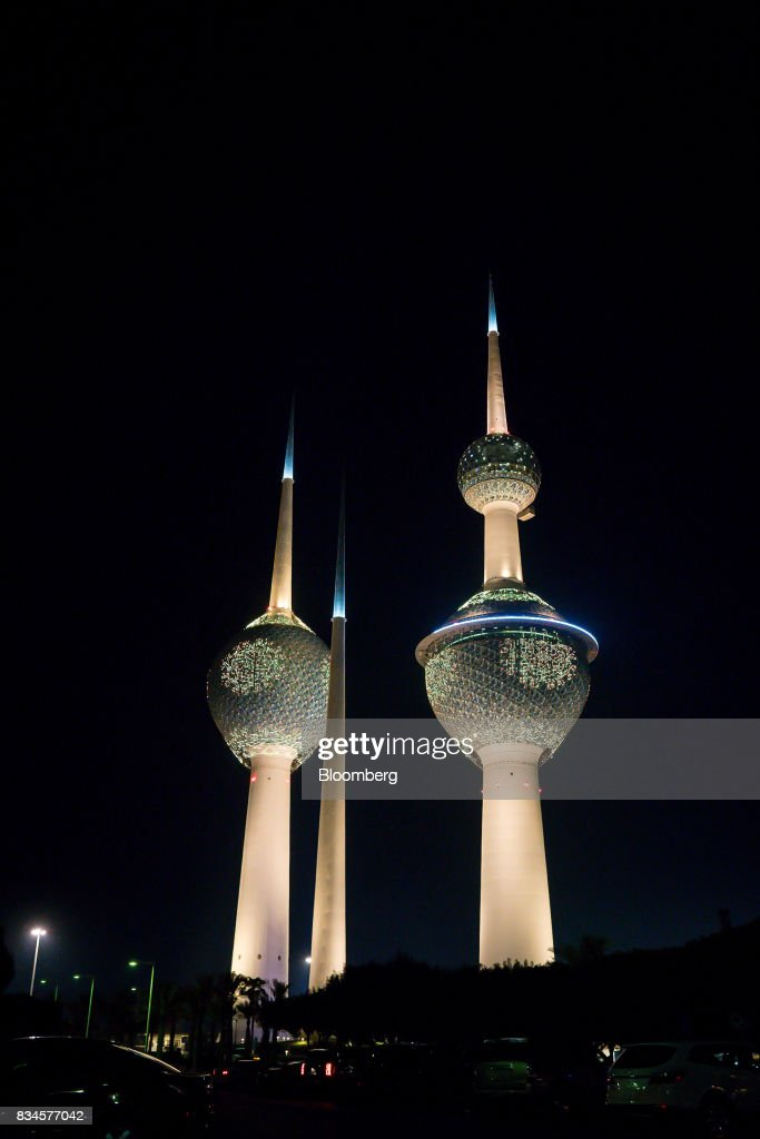 Lights illuminate the Kuwait Towers at night in Kuwait City, Kuwait, on Monday, Aug. 14, 2017. Kuwait will issue a tender to build the estimated $1.2 billion Dibdibah solar-power plant in the first quarter of 2018 as part of the countrys plans to produce 15 percent of power from renewable energy by 2030. Photographer: Tasneem Alsultan/Bloomberg via Getty Images