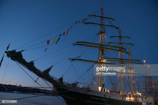 Lights illuminate the masts of the Alexander von Humboldt II ship before the tall ships parade in Quebec City on July 23 2017 The Quebec City and...