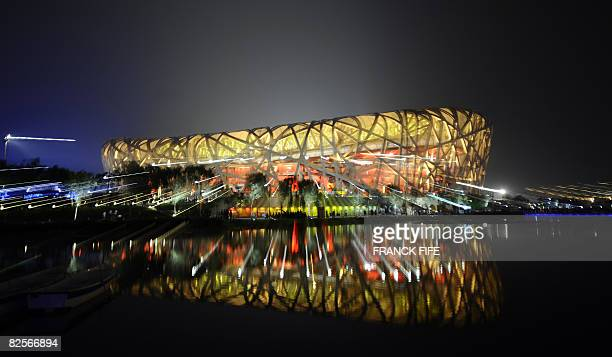 Lights illuminate the National Stadium or 'Birds Nest' during the closing ceremony of the 2008 Beijing Olympic Games in Beijing on August 24, 2008....