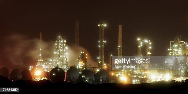 Lights illuminate the night sky from the Elf/Murco oil refinery on August 9 2006 in Milford Haven Wales Oil prices this week have hit record highs at...